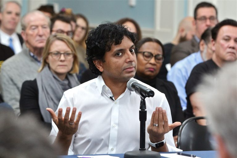 Filmmaker M. Night Shyamalan testifies in support of film tax credits during a hearing before the Pennsylvania House Democratic Policy Committee, held at the Museum of the American Revolution in Philadelphia. (Emma Lee/WHYY)