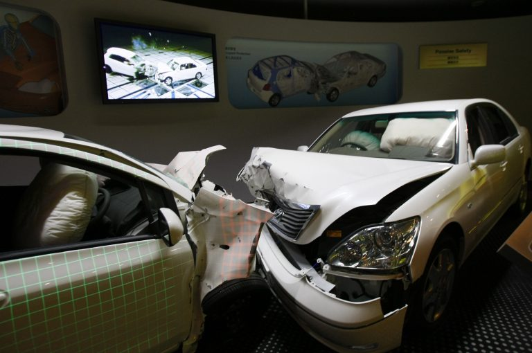 Crashed cars with airbags deployed are shown to visitors as part of the display of Toyota Motor Corp.'s safety performance standards, called