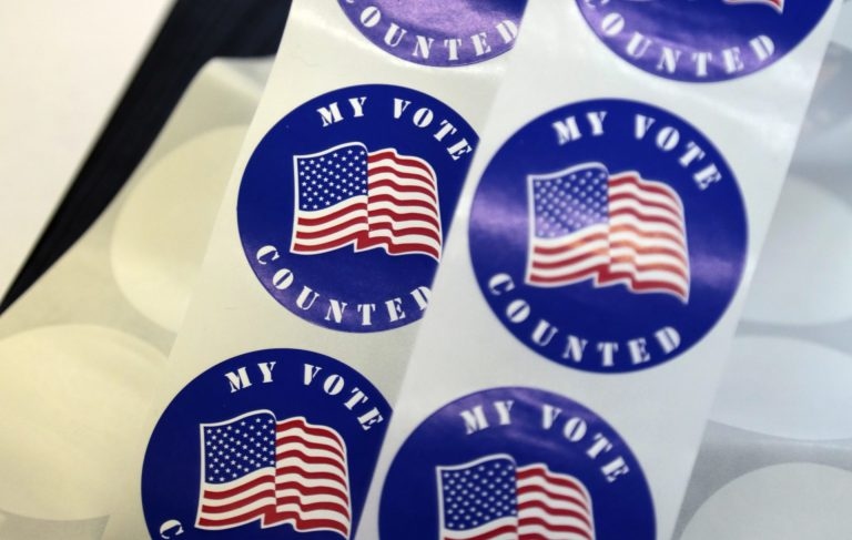Stickers for voters are seen on a table at a polling station Tuesday, April 26, 2016 in Wayne, Pa. (Jacqueline Larma/AP Photo)