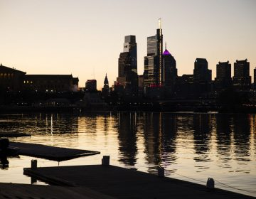 The skyline is reflected in the Schuylkill River as the sun rises over Philadelphia, Thursday, Feb. 14, 2019. (Matt Rourke/AP Photo)