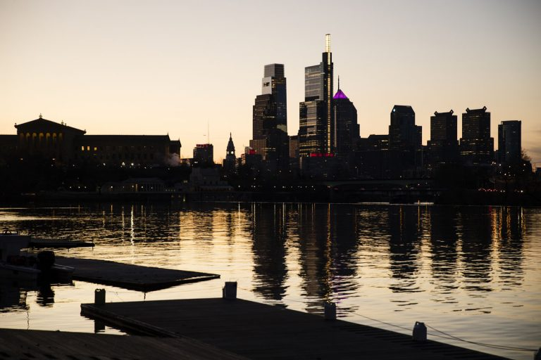 The skyline is reflected in the Schuylkill River as the sun rises over Philadelphia, Thursday, Feb. 14, 2019. (Matt Rourke/AP Photo)