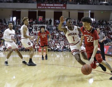Rutgers guard Caleb McConnell (22) goes to the basket against Indiana guard Aljami Durham (1) during the first half of an NCAA college basketball game, Sunday, March 10, 2019, in Bloomington, Ind. (Darron Cummings/AP Photo)