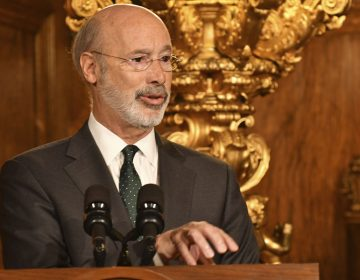 Pennsylvania Gov. Tom Wolf speaks to reporters during a news conference on his signing an executive order for his administration to start working on regulations to bring Pennsylvania into a nine-state consortium that sets a price and limits on greenhouse gas emissions from power plants, Thursday, Oct. 3, 2019 in Harrisburg, Pa. (Marc Levy/AP Photo)