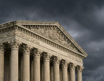 In this June 20, 2019 file photo, The Supreme Court is seen under stormy skies in Washington.  The Supreme Court is adding an abortion case to its busy election-year docket. The justices have agreed to take up a Louisiana law that could leave the state with just one clinic. (J. Scott Applewhite/AP Photo)