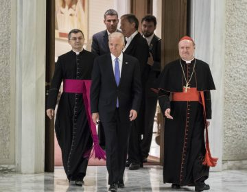 In this file photo, former Vice President Joe Biden is flanked by Cardinal Gianfranco Ravasi (right) as he arrives to attend a special audience celebrates by Pope Francis with participants at a congress on the progress of regenerative medicine and its cultural impact in the Paul VI hall in Vatican City, Vatican. (Giuseppe Ciccia/Pacific Press)