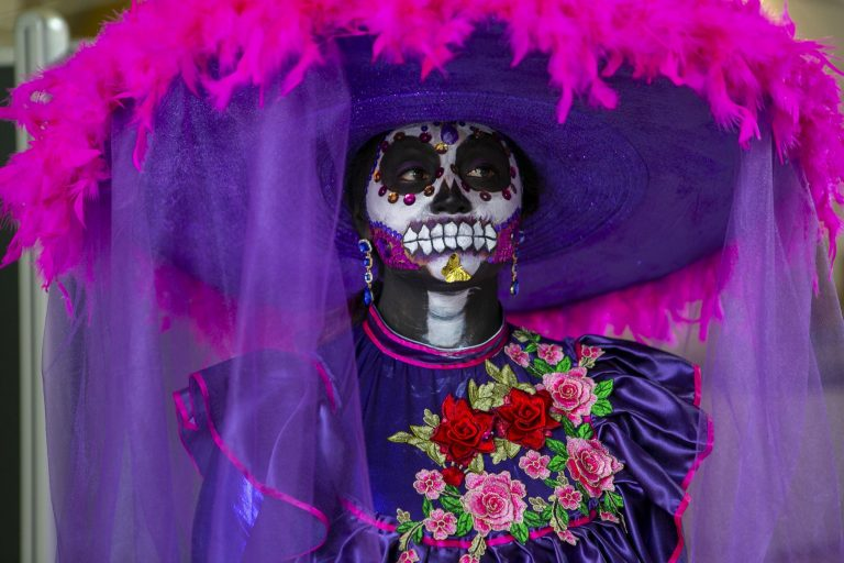 Rosa E. Ruiz wears an elaborate costume during a celebration of the Mexican tradition, Day of the Dead, at the Penn Museum in Philadelphia. (Miguel Martinez for WHYY)