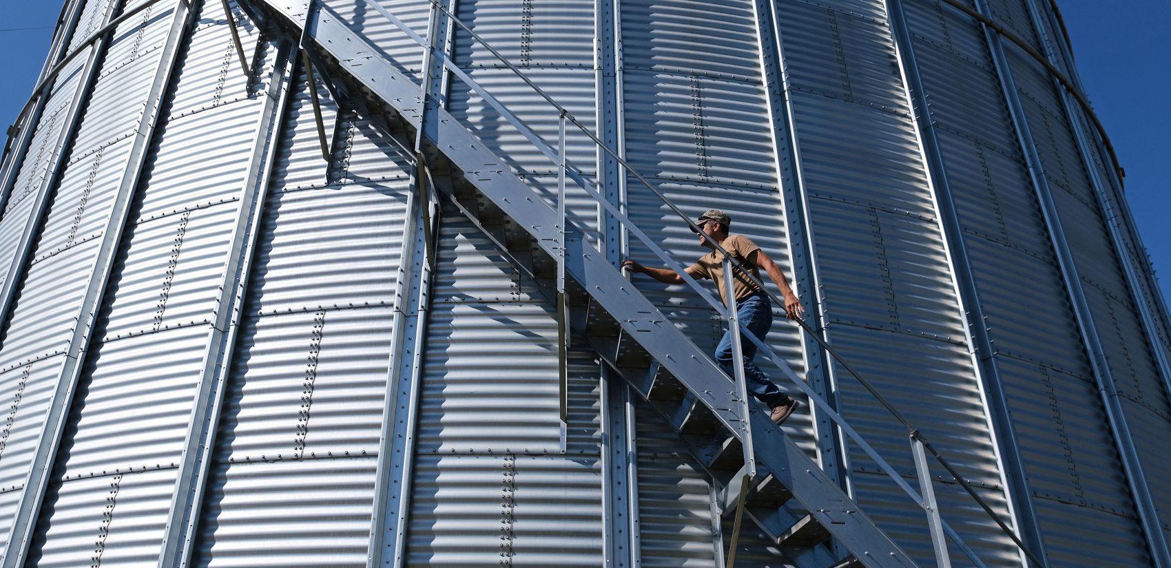 Grain farmer Don Cairns walks to the top of a grain silo Sept. 25, 2019, at Cairns Family Farm in Sadsbury Township, Pennsylvania. (Matt Smith for Keystone Crossroads)