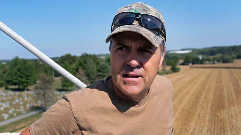 Grain farmer Don Cairns looks out over land he farms while atop a grain silo Sept. 25, 2019, at Cairns Family Farm in Sadsbury Township, Pennsylvania. (Matt Smith for Keystone Crossroads)