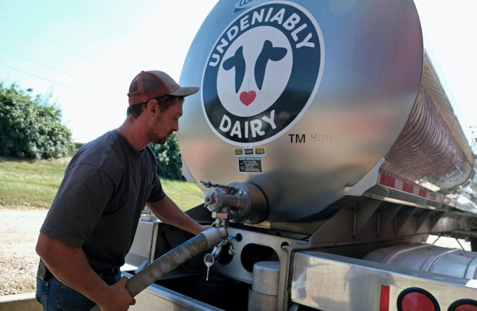 Brian Kuntzman, of Pottstown, works on filling a tanker truck with milk for delivery Sept. 25, 2019, at Ar-Joy Farms in West Fallowfield Township, Pennsylvania. (Matt Smith for Keystone Crossroads)
