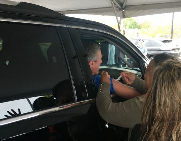 Hundreds of people, including Delaware Gov. John Carney, got their flu vaccine during a drive-thru clinic in Dover on Tuesday. (Mark Eichmann/WHYY)