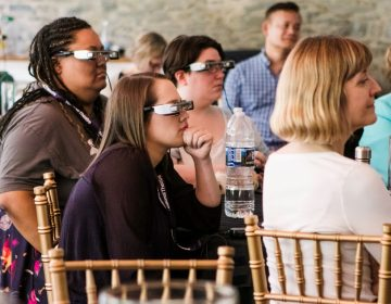 People's Light staff tries on the glasses. At the right foreground is Lisa Sonneborn, director of media arts and culture at Temple University's Institute on Disabilities, one of the partners in the project to bring the Smart Caption Glasses to the United States. (Courtesy of People's Light)
