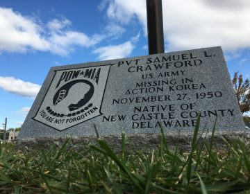 A monument outside the Route 9 Library in New Castle honors the memory of Samuel Crawford, a Wilmington soldier who went missing in action in North Korea in 1950. (Mark Eichmann/WHYY)