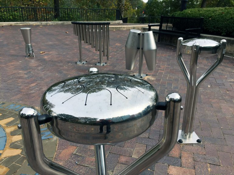Drums and other instruments installed by the Rotary Club of Wilmington at H. Fletcher Brown Park on the northern edge of downtown Wilmington will allow visitors of all ages to discover their inner musician. (Mark Eichmann/WHYY)