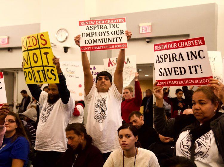Students and parents show support for ASPIRA Charter Schools at Olney and Stetson at the Philadelphia Board of Education meeting on October 17. (Kimberly Paynter/WHYY)