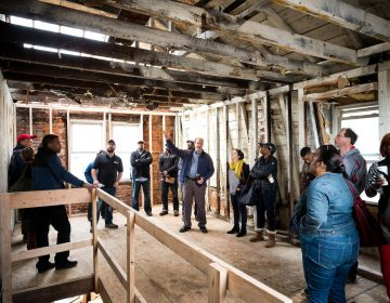 Jumpstart Germantown participants talk development at a project site. (Courtesy of Jumpstart Germantown)