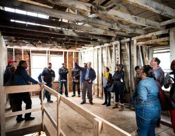 Jumpstart Germantown participants talk development at a project site.  (Courtesy of Jumpstart Germantown)