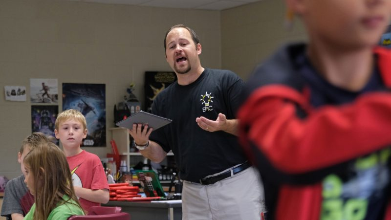 Discovery teacher Matt Derr instructs students as they work with a tornado simulation augmented reality program on smartphones Sept. 26, 2019, at Whitfield Elementary School in Spring Township, Pennsylvania.  (Matt Smith for Keystone Crossroads)