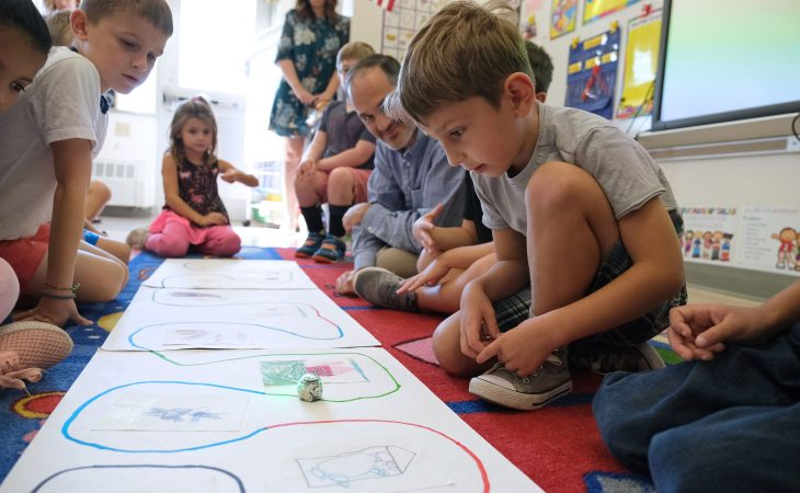 Claudiu Iordanescu, right, 6, works with Ozobots to tell a story alongside fellow students Sept. 26, 2019, at Mifflin Park Elementary School in Cumru Township, Pennsylvania.  (Matt Smith for Keystone Crossroads)