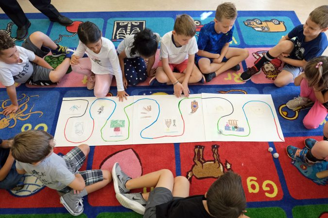 First-grade students work with Ozobots to tell a story Sept. 26, 2019, at Mifflin Park Elementary School in Cumru Township, Pennsylvania. (Matt Smith for Keystone Crossroads)