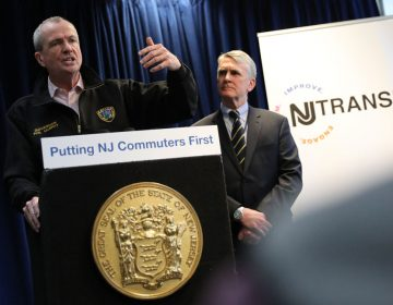 Gov. Phil Murphy speaks about investing in NJ Transit as Kevin Corbett, the agency's executive director, looks on, March 19, 2019. (Edwin J. Torres/ Governor's Office)
