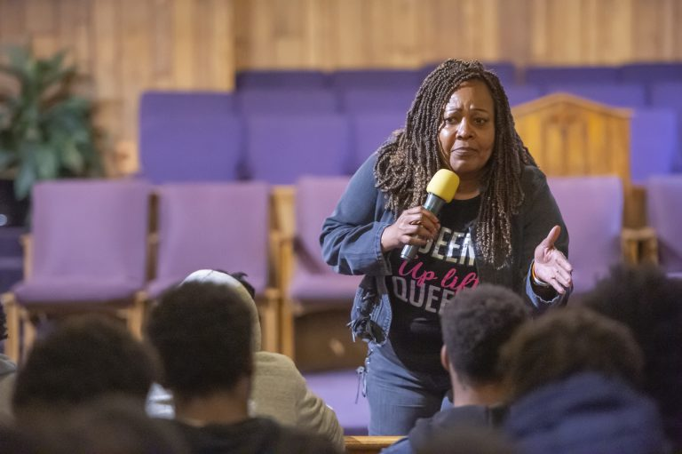 Guardian Civic League President and Democratic nominee for Philadelphia Sheriff Rochelle Bilal explains to a  young audience best practices for encounters with police officers when they are stopped for questioning. (Jonathan Wilson for WHYY)