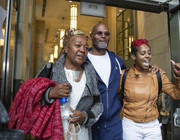 Willie Veasy (center) walks out of the Center for Criminal Justice as a free man after being in prison for 27 years along with his sister, Ketra Veasy (right), and Debra Chappell  on Wednesday, Oct. 09, 2019. (Heather Khalifa/The Philadelphia Inquirer)