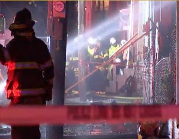 Row home explosion sparks fire. (NBC 10)