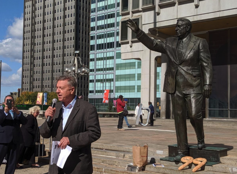 'That's good news,' says 1210WPHT radio host Dom Giordano on Wednesday upon learning of the Kenney administration's new schedule for removing the Frank Rizzo statue in Center City. Giordano spoke an event commemorating the 99th birthday of the former mayor, where supporters placed Italian bread loaves in the shape of the number 99 at the based of the statue. (Michael D'Onofrio/The Philadelphia Tribune)