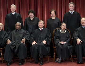The Supreme Court justices, pictured in November 2018, start a new term on Monday. (J Scott Applewhite/AP)