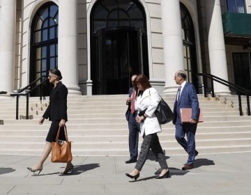 Attorneys and other people leave the U.S. District Court in September after Purdue Pharma's first hearing since filing for bankruptcy in White Plains, N.Y. (Seth Wenig/AP Photo)