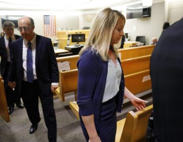 Fired Dallas police officer Amber Guyger leaves the courtroom after a jury found her guilty of murder Tuesday. Guyger shot and killed Botham Jean, an unarmed 26-year-old neighbor in his own apartment last year. She told police she thought his apartment was her own and that he was an intruder. (Tom Fox/Tom Fox/The Dallas Morning News via AP)