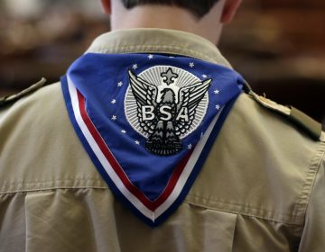 A Boy Scout wears an Eagle Scout neckerchief