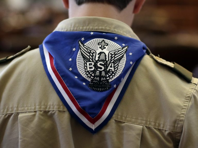 A Boy Scout wears an Eagle Scout neckerchief during the annual Boy Scouts Parade and Report to State in the House Chambers at the Texas State Capitol, February 2013, in Austin, Texas. (Eric Gay/AP Photo)