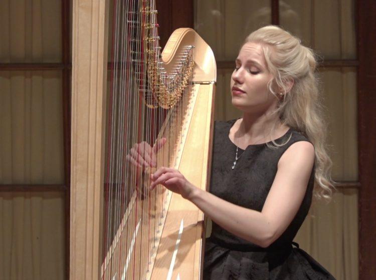 Curtis student Alexandra Tihonova playing the harp.