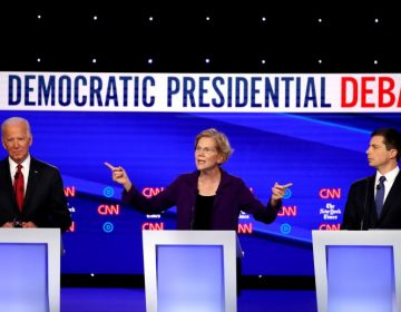 Left to right, former Vice President Joe Biden, Massuchusetts Sen. Elizabeth Warren and South Bend, Ind. Mayor Pete Buttigieg react on stage during the Democratic Presidential Debate at Otterbein University. (Getty Images)