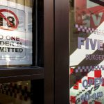 A sign in the door of a Center City Five Guys bans kids under 18 from entry (Michaela Winberg/Billy Penn )