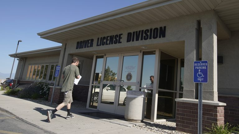 A person walks into a Utah Driver License Division office in July in Orem, Utah. (George Frey/Getty Images)