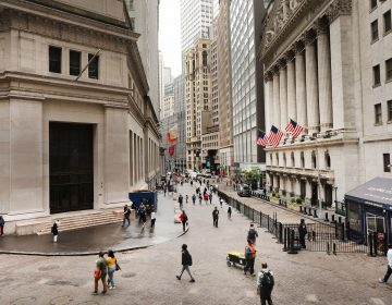 Investors are spending billions of dollars to align their portfolios with their personal values. Above, pedestrians walk past the New York Stock Exchange on June 10. (Spencer Platt/Getty Images)