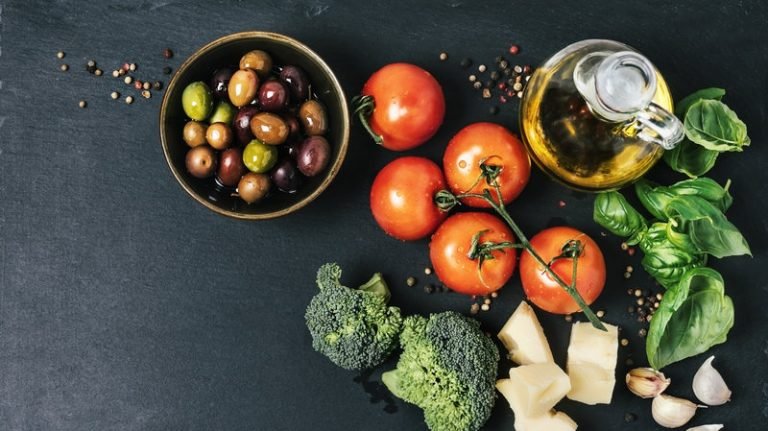 Depression symptoms dropped significantly in a group of young adults who ate a Mediterranean-style diet for three weeks. It's the latest study to show food can influence mental health. (Claudia Totir/Getty Images)