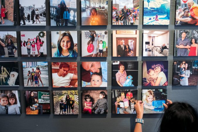 Gisele Fetterman, the Second Lady of Pennsylvania hangs family photos in her Braddock home. Sept. 19, 2019. (Sean Simmers/PennLive)