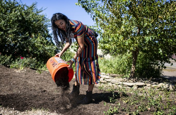 Gisele Fetterman puts down some mulch at Hollander's in Braddock, Pa.Hollander's is a co-working space and business incubator for minority, female entrepreneurs from Braddock and surrounding Mon Valley communities. Sept. 19, 2019. (Sean Simmers/PennLive)