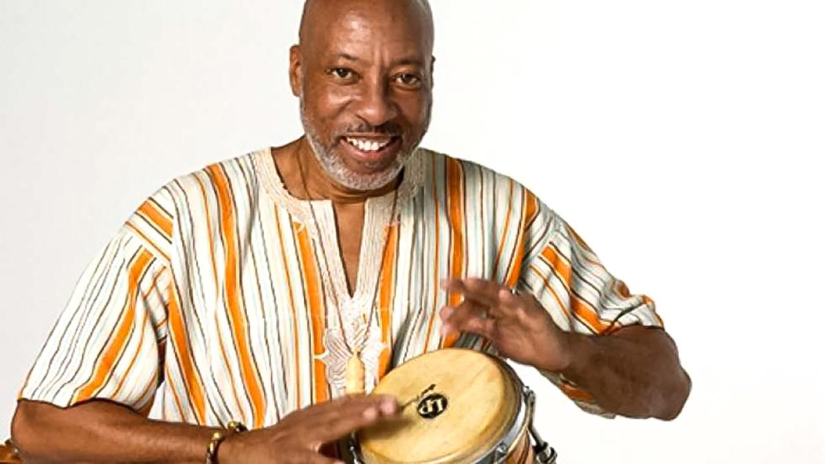 Madafo Lloyd Wilson playing drums in the Kwanzaa program, A Season's Griot