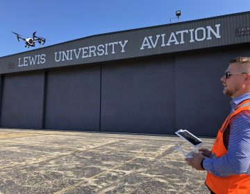 Jacob Reed, director of the Unmanned Aircraft Systems degree program at Lewis University, demonstrates a drone at the school's airfield outside of Chicago. (David Schaper/NPR)