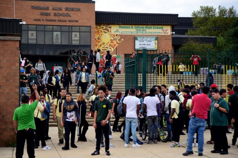 Students spill out of Thomas A. Edison High School at the end of the school day. Students who swipe their identification cards in the morning are considered present for the whole day — even when they cut class. (TOM GRALISH / Philadelphia Inquirer)
