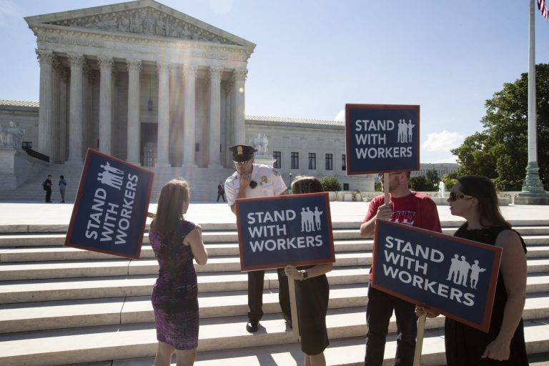 People gather at the Supreme Court awaiting a decision in an Illinois union dues case, Janus vs. AFSCME, in Washington, Monday, June 25, 2018. The outcome of that case and several others were not announced Monday as the court's term comes to a close. (J. Scott Applewhite/AP Photo)