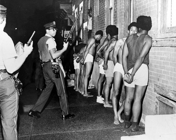 Members of the Black Panther Party, stripped, handcuffed, and arrested after Philadelphia police raided the Panther headquarters, August, 1970. El-Mekki's father, Hamid Khalid, is 3rd from right. (Photo courtesy of Urban Archives, Temple University)