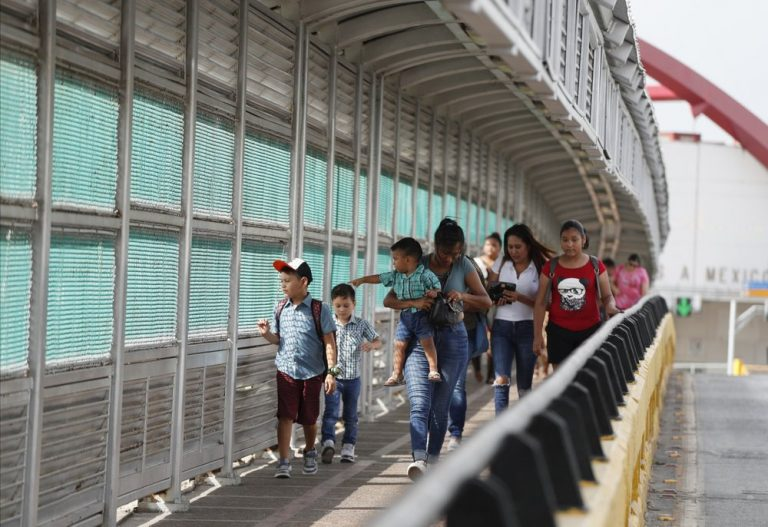 In this June 28, 2019 file photo, local residents with visas walk across the Puerta Mexico international bridge to enter the U.S., in Matamoros, Tamaulipas state, Mexico. (Rebecca Blackwell/AP Photo)