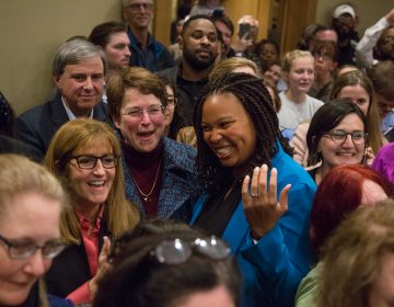 Elaine Paul Schaefer (left center), Christine Reuther, and Monica Taylor celebrate their historic win for the three open seats on the Delaware County Council. (Emily Cohen for WHYY)