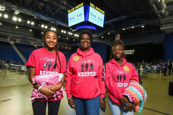 Volunteers (from left) Aniua Brown, 14, Charlotte Miller-Lacy and Christina Cooper, 17, from I am My Sister's Keeper during Kind to Kids Foundation's 4th Annual My Blue Duffel Community Service Day Sunday.  (Saquan Stimpson for WHYY)
