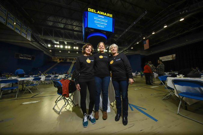 Volunteers (from left) Linda Jones, Marie Cantrell and Breda Buckley pose together for a photo during Kind to Kids Foundation's 4th Annual My Blue Duffel Community Service Day Sunday. (Saquan Stimpson for WHYY)